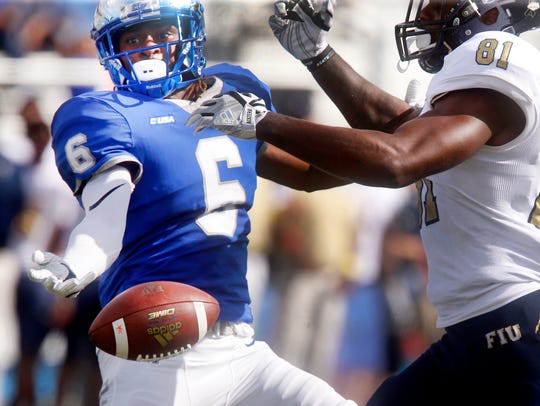 MTSU's Mike Minter Jr. (6) misses a possible interception on a pass intended for FIU's Thomas Owens (81) last season.
