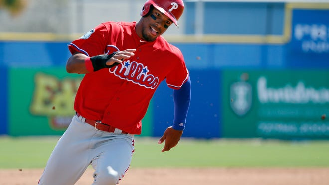 Philadelphia Phillies right fielder Nick Williams runs home to score a run in a spring training game against the Toronto Blue Jays at Florida Auto Exchange Stadium.