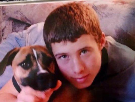 Boy with Roxy photo.jpg
