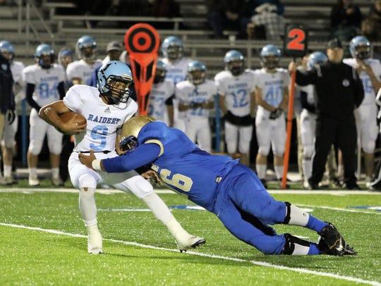 Huntingdon defensive lineman Damion Byrd tackles a