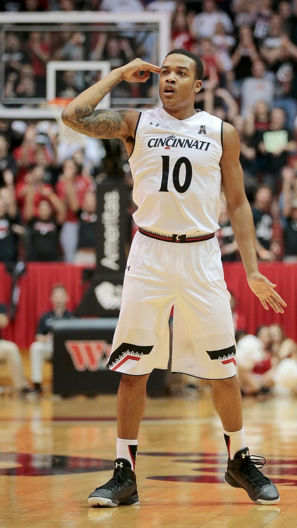 Cincinnati Bearcats guard Troy Caupain (10) celebrates after scoring a three-point basket in the first half of the NCAA Men's Basketball exhibition game between the Cincinnati Bearcats and the Grand Valley State Lakers at Fifth Third Arena on the campus of the University of Cincinnati in Cincinnati on Tuesday, Nov. 3, 2015.