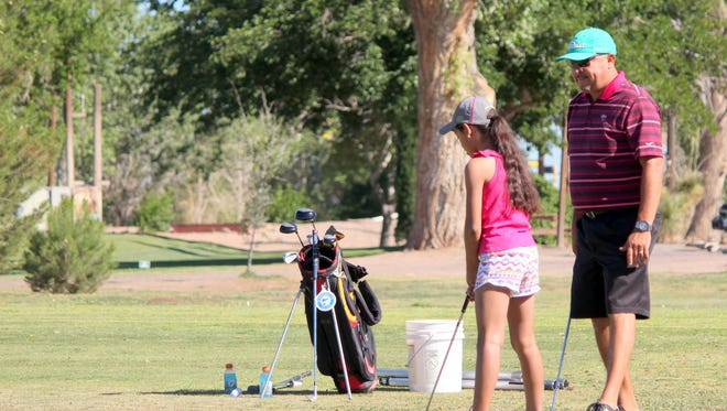 The Deming Junior Golf League practices at the Rio Mimbtres Golf Course.