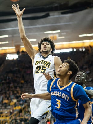 Iowa forward Dom Uhl (25) goes to the basket during the second half against Missouri-Kansas City. The Hawkeyes won the game 95-75.
