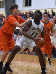 Our Lady of Lourdes High School's James Anozie is covered by Marlboro's, from left, Jack Rusk and Xavier Oliver during the 2015 Duane Davis Memorial Holiday Tournament final in Poughkeepsie.