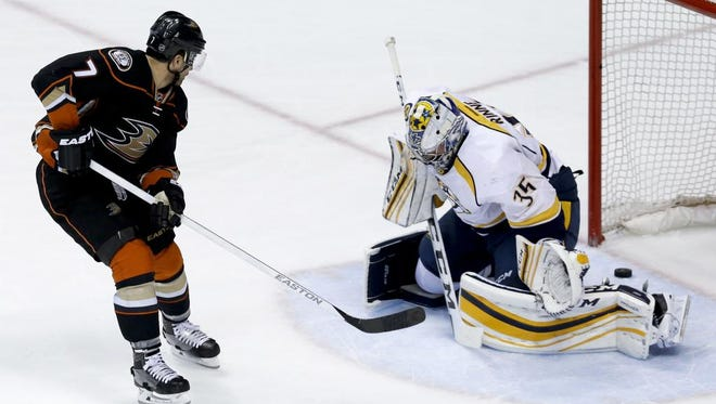 Anaheim Ducks center Andrew Cogliano, left, scores past Nashville Predators goalie Pekka Rinne during the first period of Game 2 of an NHL hockey first-round Stanley Cup playoff series in Anaheim, Calif., Sunday, April 17, 2016. (AP Photo/Chris Carlson)