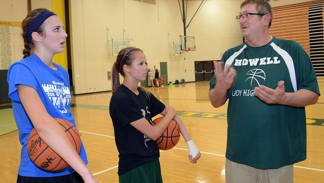 New Howell girls basketball coach Tim Olszewski talks with Erin Honkala, far left and Alexis Miller during a recent offseason workout. Olszewski coached boys at Fenton for 12 seasons before taking over the Howell girls program.