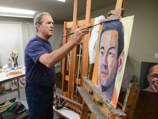 Former President George W. Bush worked on a painting
