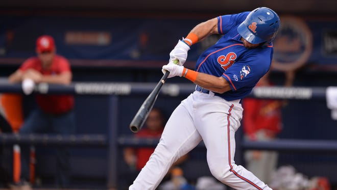 Tim Tebow hits a single up the middle during his second at-bat with the St. Lucie Mets against the Palm Beach Cardinals during a double-header Wednesday, June 28, 2017, at First Data Field in Port St. Lucie. Tebow was originally going to play in his first Florida State League game Tuesday, but it was postponed due to weather.