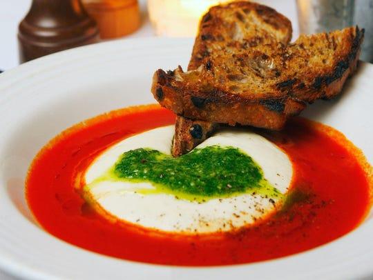 Warm hand-pulled mozzarella with basil pesto and tomato broth at Rancho Pinot.