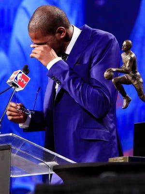 Thunder forward Kevin Durant wipes away a tear during his 2013-14 NBA MVP Award speech Tuesday.