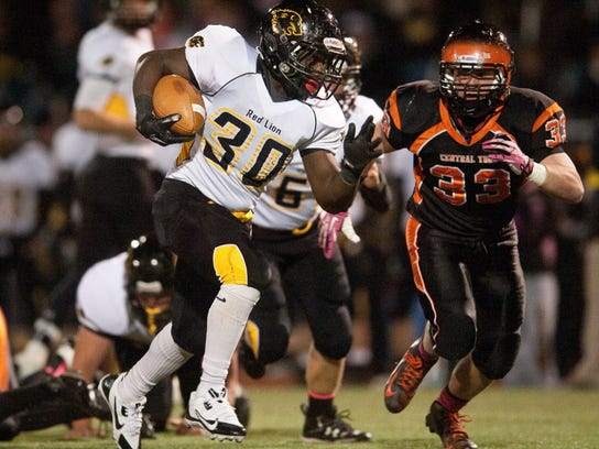 Running back Kenny Holloway, left, and Red Lion are among the YAIAA Division I teams hoping to unseat champion Central York. (FILE -- GAMETIMEPA.COM)