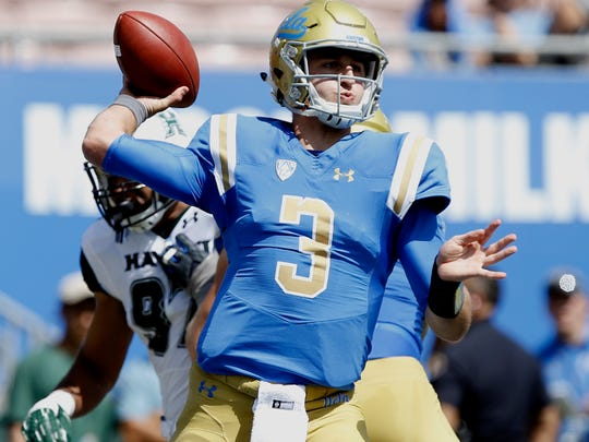 UCLA quarterback Josh Rosen throws his first pass complete for 18 yards against Hawaii during the first half of an NCAA college football game in Pasadena, Calif., Saturday, Sept. 9, 2017. (AP Photo/Alex Gallardo)