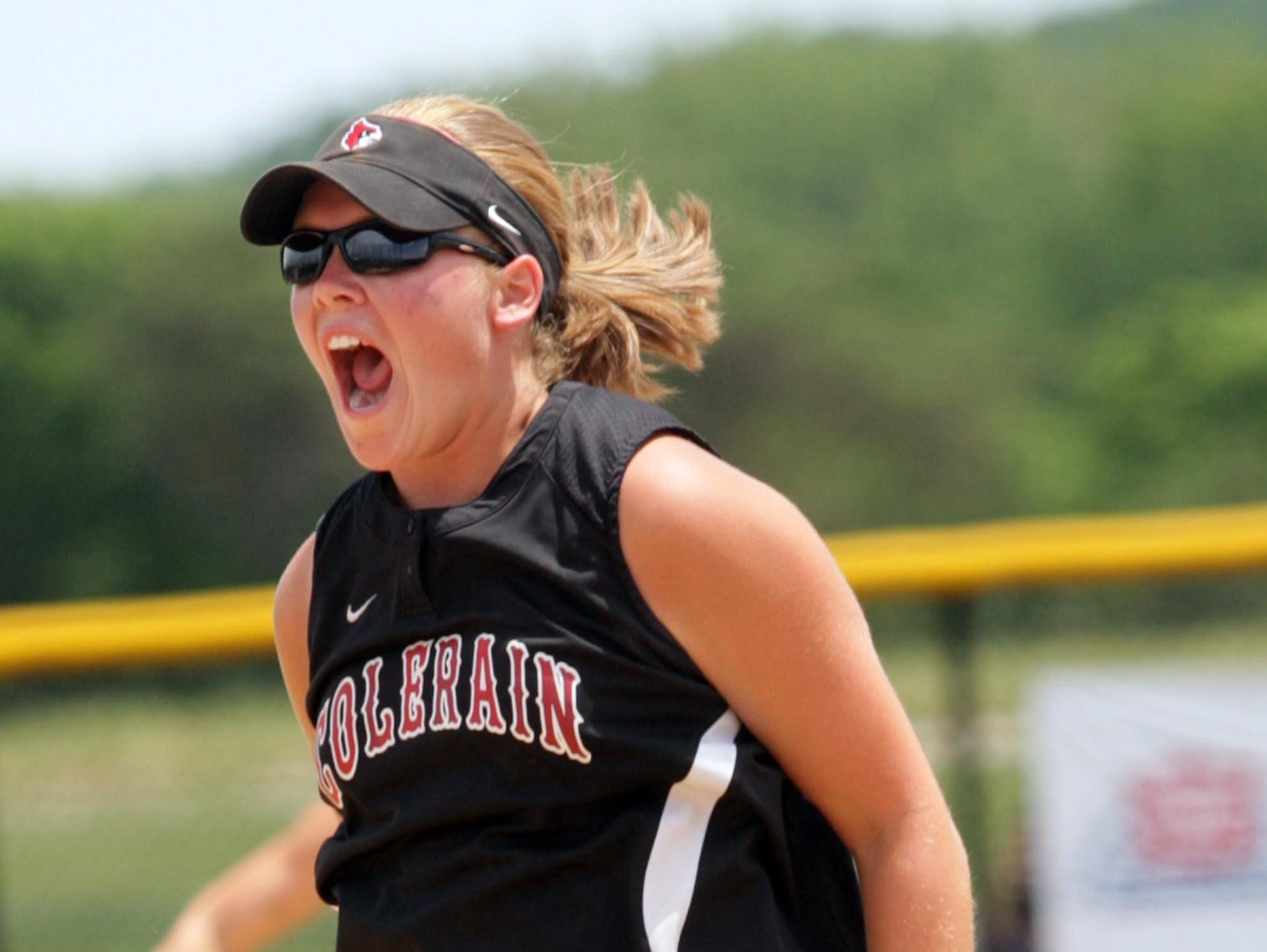Colerain pitcher Emily Schwaeble jumps in the air after striking out the last batter to complete a perfect game in a Division I regional final May 30, 2009. Schwaeble was named head softball coach at Colerain on June 30.
