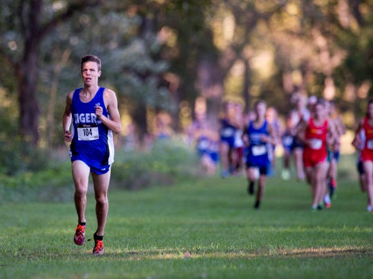 Memorial's Matt Schadler leads the boys varsity race during the SIAC cross country meet at Angel Mounds in Evansville, Ind., on Saturday, Sept. 30, 2017. Schadler finished first with a time of 15:40.
