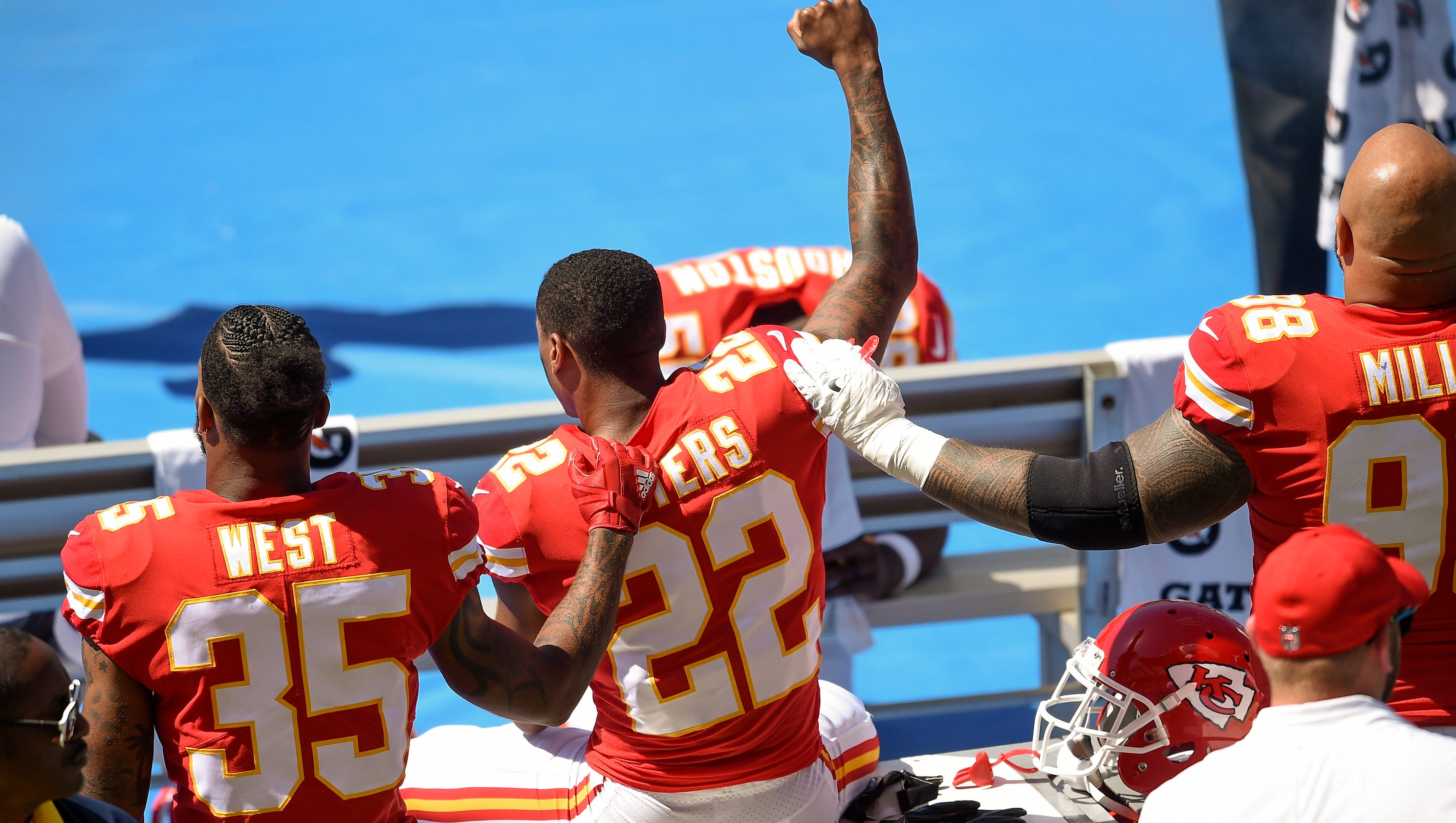 Image result for marcus peters kneeling