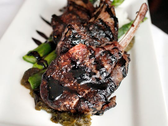 Coffee/cocoa-encrusted rack of lamb with a spring onion jam, creamy polenta, asparagus and drizzled with a balsamic reduction at Buck's Restaurant and Bar in Old Louisville.