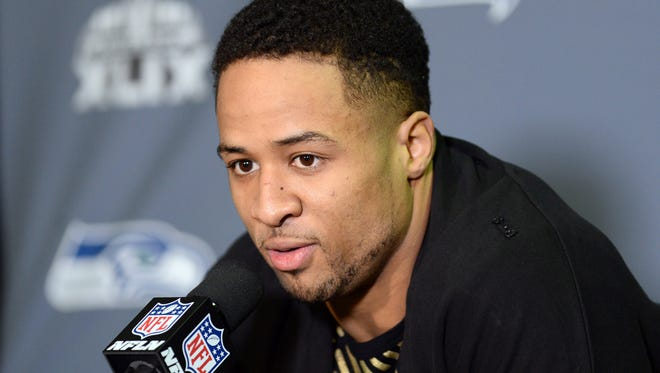 Jan 25, 2015; Phoenix; Seattle Seahawks safety Earl Thomas fields and answers questions during at press conference in preparation for Super Bowl XLIX.