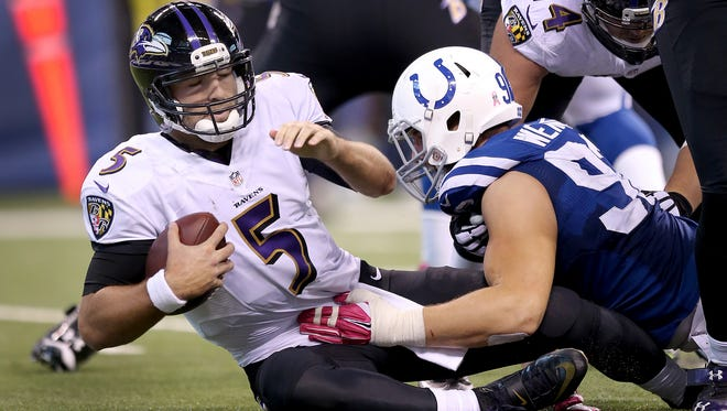 The Indianapolis Colts defeated the Baltimore Ravens 20-13 Sunday, October 5, 2014, afternoon at Lucas Oil Stadium. Indianapolis Colts Bjšrn Werner sacks Baltimore Ravens Joe Flacco in the second half of their game.