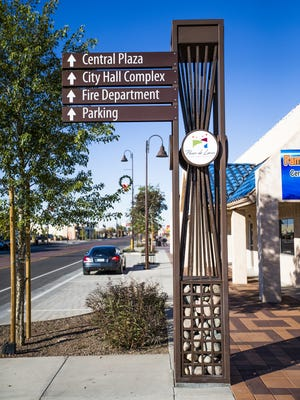 The section of downtown Tolleson between 91st and 94th Avenues on Van Buren street has been beautified by the Paseo de Luces project, including statues, seating areas, new street signs, and decorative sidewalks.