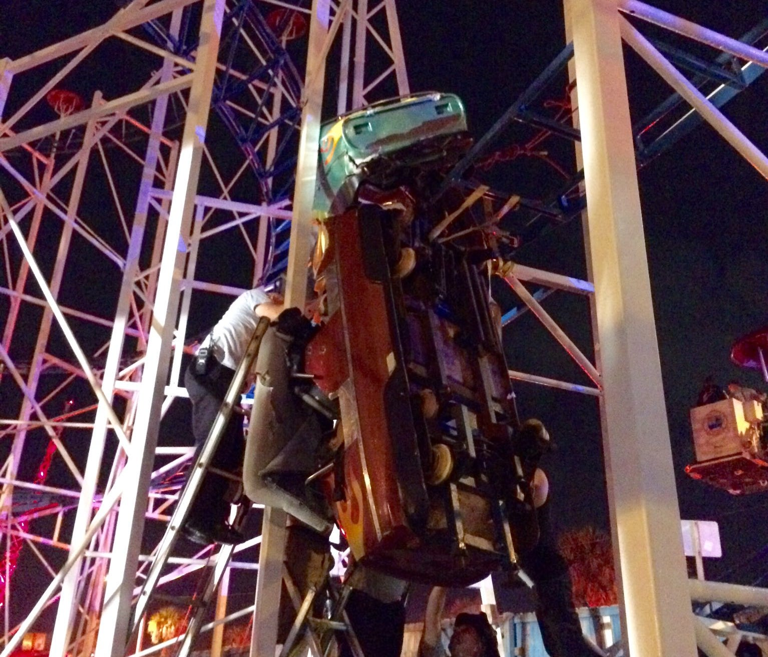 A roller coaster derailed at the Daytona Beach boardwalk in Florida on Thursday night, injuring multiple passengers and leaving a car dangling from the track.