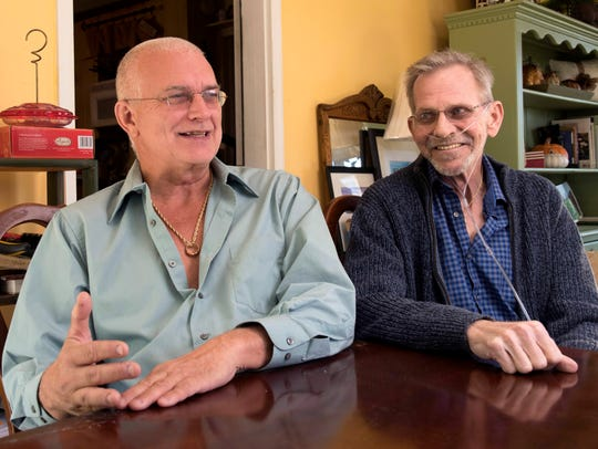 Bruce Mead-e, 63, right, at home with husband Chuck