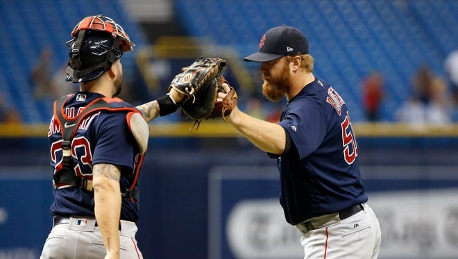 Boston Red Sox relief pitcher Blaine Boyer (51) and catcher Blake Swihart (23) congratulate each other as they beat the Tampa Bay Rays during the 15th inning at Tropicana Field.