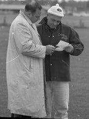 Green Bay Packers business manager Jack Vainisi, left, huddles with coach Vince Lombardi at practice on Oct. 13, 1959. Vainisi and Lombardi were the architects of the Packers' championship teams of the 1960s. Vainisi, the Packers' top scout, started finding and drafting those teams' key players as early as 1952.