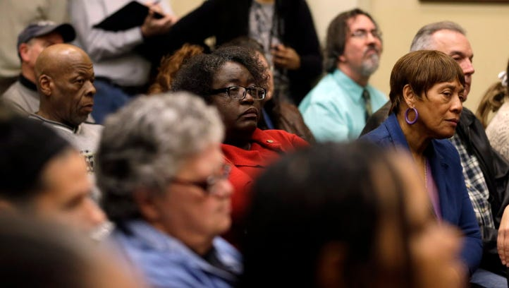 People attend a city council meeting Tuesday, Feb. 2, 2016, in Ferguson, Mo. The meeting was the first opportunity for residents to speak directly with city leaders following a preliminary consent agreement with the U.S. Department of Justice that would overhaul of police policies, training and practices, fallout from the fatal police shooting of 18-year-old Michael Brown in 2014.