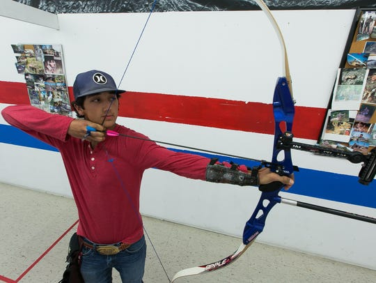 Sam Ellis practices his archery on Thursday at the