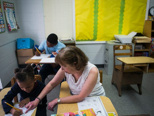 October 12, 2017 - Mary Baer, a teacher at Memphis Heritage Christian School, helps student Madison Williams, 5, with a lesson on Thursday. Williams' 12-year-old brother Raphael works on math problems. Baer, 65, is a cancer survivor who came to the school seven years ago with a new purpose in teaching children at the struggling school. She often gives up her salary when the school is financially stressed to meet budget.