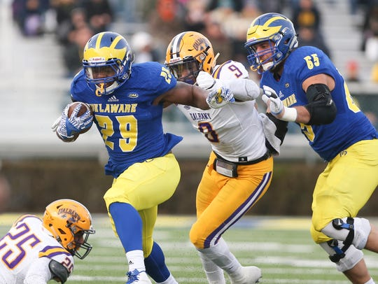 Delaware's Kani Kane (29) carries as Albany's Jamal