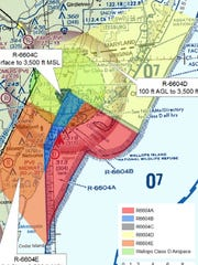 A map created by NASA shows existing restricted airspace at Wallops Flight Facility in blue and red and a proposed expansion in yellow and orange.
