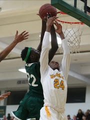 North's Jal Bijiek goes for the dunk over Hoover Huskie