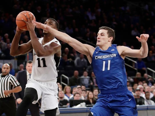 Providence's Alpha Diallo (11) drives past Creighton's Tyler Clement (11) during the first half of an NCAA college basketball game during the Big East men's tournament Thursday, March 9, 2017, in New York. (AP Photo/Frank Franklin II)