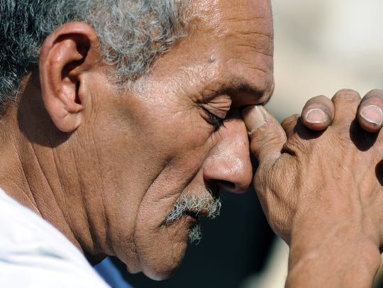 Danny H. Ruiz prays while Las Cruces Bishop Oscar Cantú
