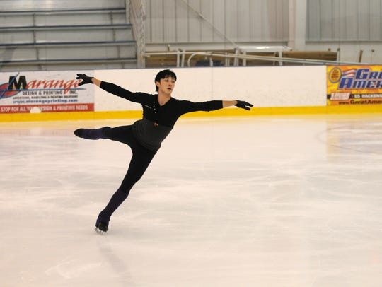 Johnny Weir, a competitive figure skater, practices
