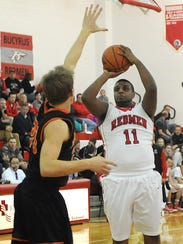 DJ Dagher shoots the ball for Bucyrus during their