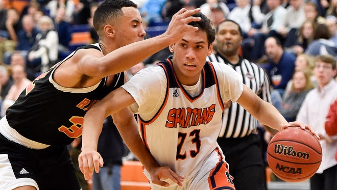Summit's John Carter (23) has led the Spartans to a 16-2 start to the season.