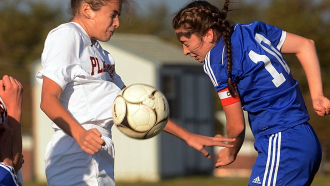Plainfield's Olivia Dagenais and Lyman Memorial's Kate Anderson battle for the ball during the Panthers' 4-1 win Thursday in Lebanon. See more photos at NorwichBulletin.com