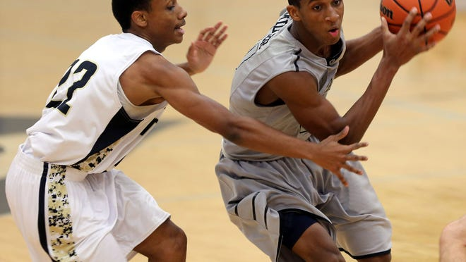 Siegel's Deante Miller moves around Mt. Juliet's Jordan Lockridge in the second half of the Stars' 73-71 double overtime victory over the Bears on Tuesday night in a nondistrict contest.