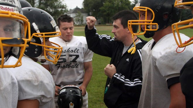 Rosholt High School football coach Adam Spindler talks to his defensive line at a recent practice.