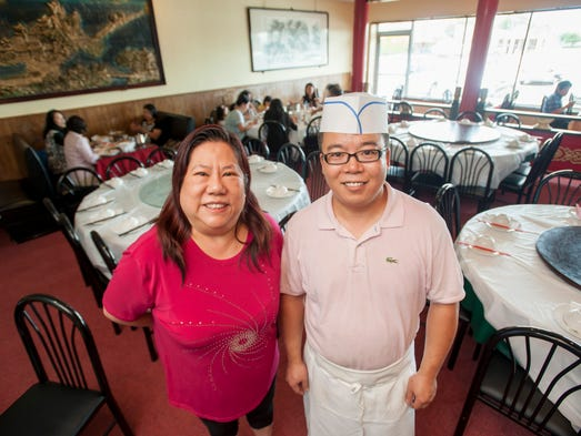 Manager Hsiaoming Wu, left, and chef Bin Sha inside