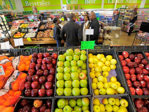 Grocery crawlers gather in the produce section, Saturday
