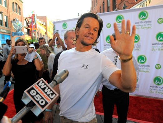 Actor/producer Mark Wahlberg waves to the crowd Wednesday