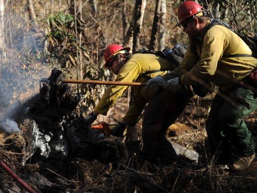 U.S. Forest Service firefighters Cash Jessop, left,