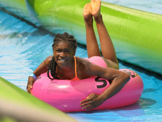Scenes from Slide the City in downtown Reno June 3,