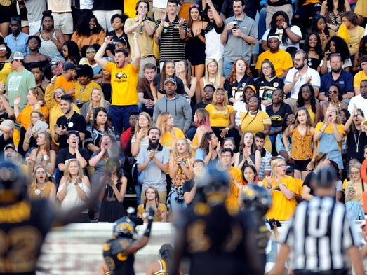 Southern Miss fans cheers for their team in a game