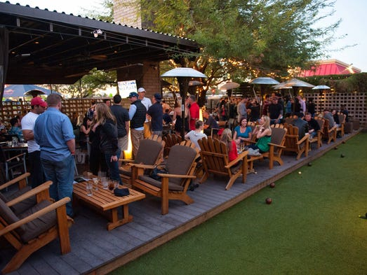 folks dine on the patio during the vig 39 s birthday block party in