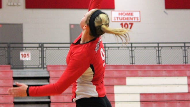 Fairfield senior Kacie Sizemore goes for the kill against Lakota West Sept. 16.