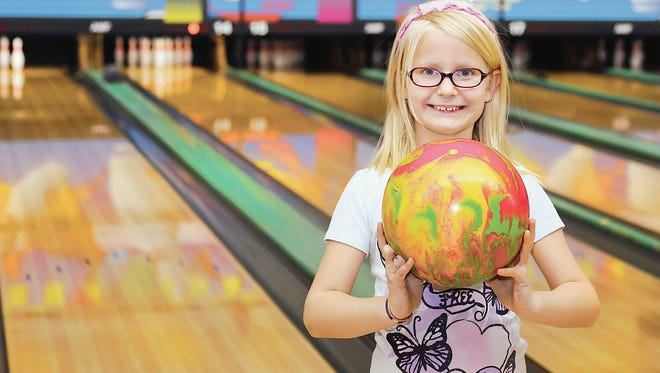 Madison Keith celebrates picking up a spare at Golden Lanes in Simpsonville.